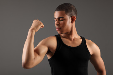 African american man showing off bicep muscles