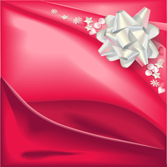 Light silver bow on red silk glossy background.