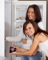 women looking for something in the  refrigerator