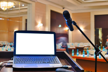 the rostrum with notebook waiting for a speaker