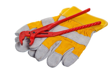 Working gloves and wrenches isolated on white