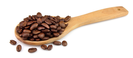 Coffee grains on a wooden spoon