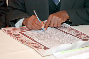 Jewish wedding, signing prenuptial agreement  ketubah