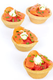Appetizers with salmon and tomatoes isolated on white background