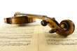 Vintage viola with head close-up and sheet music