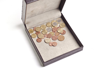 Different coins in open box isolated