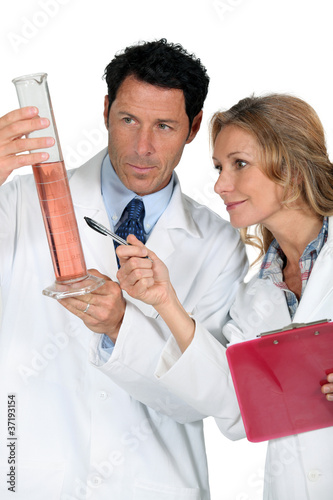 doctor and nurse holding tube