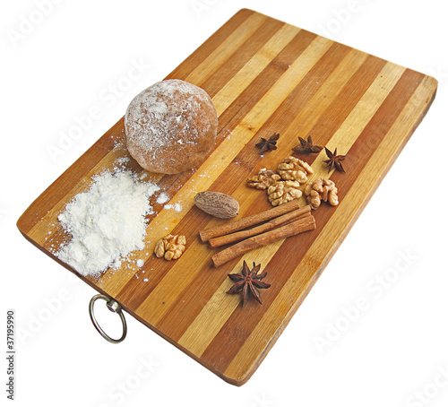 Christmas spices and dough on wooden board