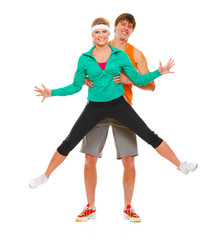 Fitness girl and man in sportswear having fun isolated on white