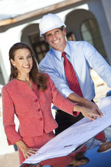 Man Architect & Woman With Plans on Construction Site