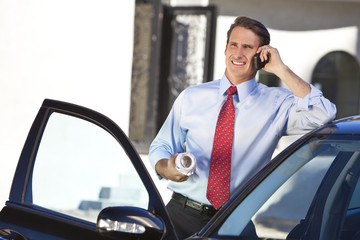 Businessman or Architect On Cell Phone By Car