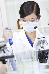 Chinese Female Woman Scientist Using Pipette In Laboratory
