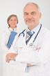Medical doctor team seniors hold folders