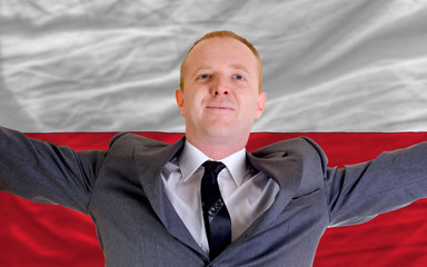 happy businessman because of profitable investment in poland sta
