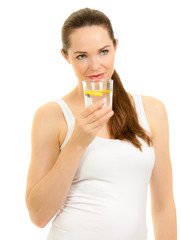 Beautiful woman drinking a glass of water