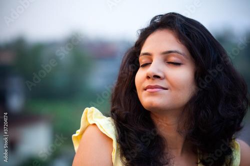 Beautiful Indian girl taking breath