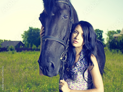 Beautiful young woman and horse