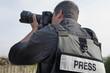 Leinwandbild Motiv Professional Photojournalist