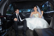 Happy couple in limousine