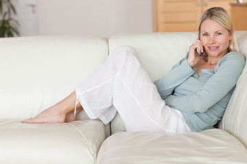 Woman sitting on the couch listening to caller