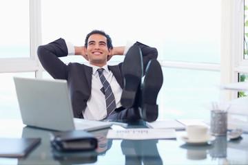 Satisfied businessman relaxing