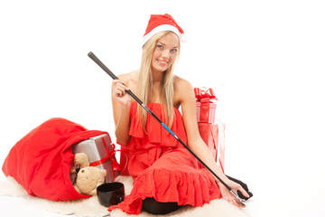 With a golf club and presents