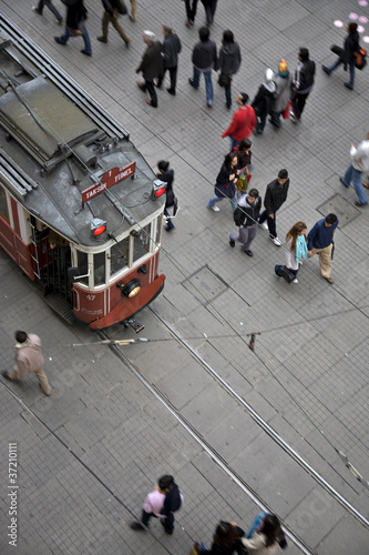 Tram and walking people on Istiklal Street