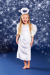 funny blond christmas angel with sparkling stars