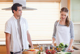 Couple having a tensed situation in the kitchen