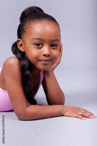Cute little African American girl smiling
