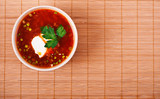 bowl of borscht on bamboo table cloth