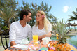 Couple having breakfast in luxury resort