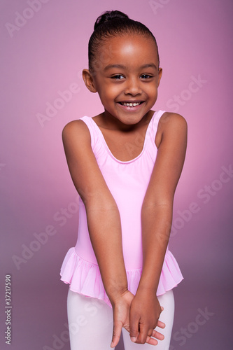 Cute little African American girl wearing a ballet costume
