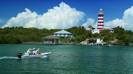 Tropical Island Lighthouse with Passing Craft