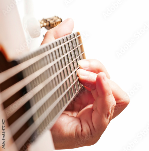 Woman hand playing guitar