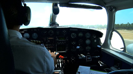 Pilot in Cockpit of Light Aircraft