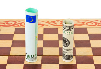 Dollar and euro on chess board