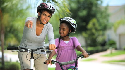 EthnicMother & Daughter Bike Riding Together