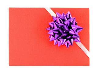 gift card with violet ribbin bow on white background