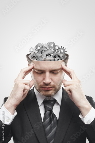 Open minded man with gears and cogs inside