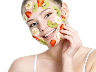 Woman with fruit facial mask on face