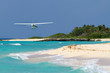 Small tourist plane over Caribbean beach in Mexico