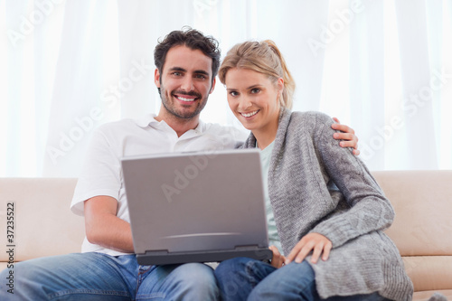 Young couple using a notebook