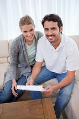 Portrait of a happy couple reading a letter