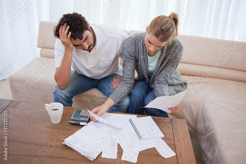 Depressed couple doing their accounting