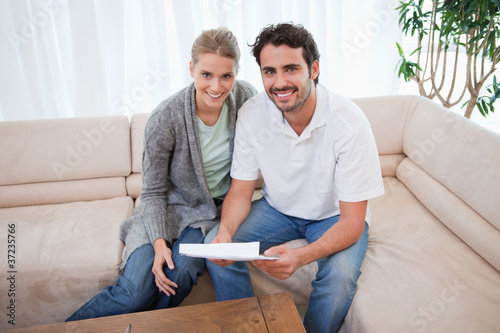 Smiling couple reading a letter