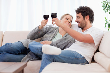 Young couple having a glass of wine