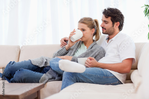 Young couple having a cup of tea