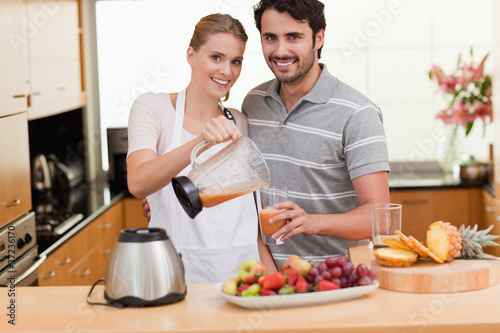 Couple drinking fruits juice