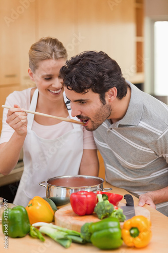Portrait of a young couple preparing a sauce